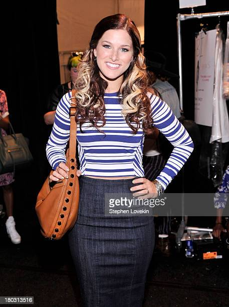Musician Cassadee Pope prepares backstage at the Nanette Lepore fashion show during MercedesBenz Fashion Week Spring 2014 at The Stage at Lincoln...