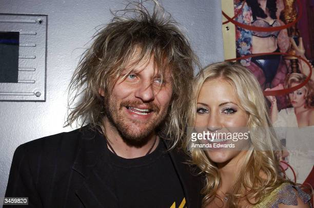 Musician CC Deville and actress Shannon Malone arrive at the record release party for Gene Simmons' 'Asshole' on April 22 2004 at the Key Club in...
