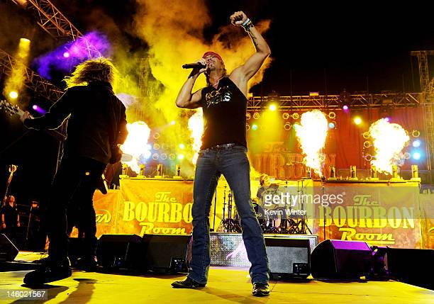 Musician C.C. DeVille, singer Bret Michaels and drummer Rikki Rockett of Poison perform at the after party for the premiere of Warner Bros. Pictures'...