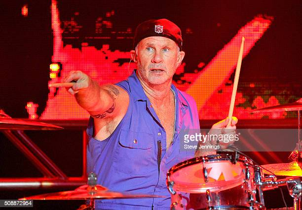 Musician Chad Smith of The Red Hot Chili Peppers performs onstage during the DirecTV Super Saturday Night cohosted by Mark Cuban's AXS TV at Pier 70...