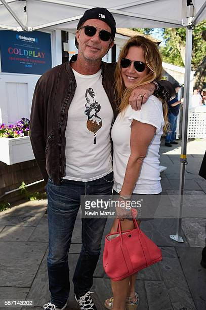 Musician Chad Smith of the Red Hot Chilli Peppers and Nancy Mack attend as Coldplay performs for SiriusXM in the Hamptons at The Stephen Talkhouse...