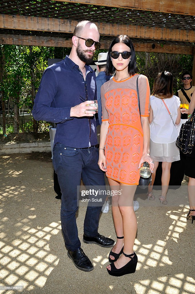 Musician Charles Cave (L) and singer Rosanna Munter of the band K.I.D.S. attend Harper's BAZAAR Coachella poolside fete at the Parker Palm Springs on April 12, 2013 in Palm Springs, California.