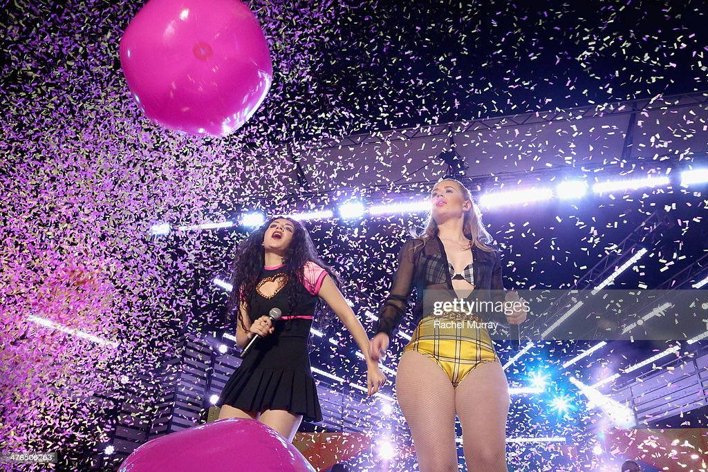 Musician Charli XCX (L) and rapper Iggy Azalea perform onstage at the 2014 mtvU Woodie Awards and Festival on March 13, 2014 in Austin, Texas.