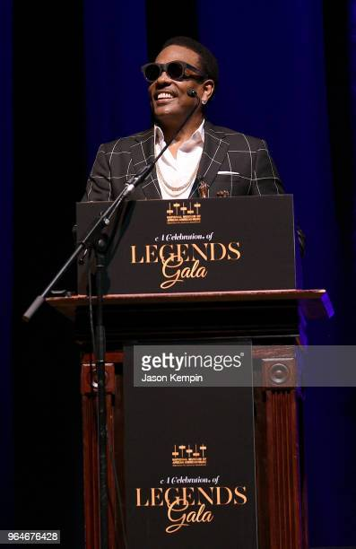 Musician Charlie Wilson accepts an award onstage during NMAAM Celebration of Legends Galaon May 31 2018 in Nashville Tennessee
