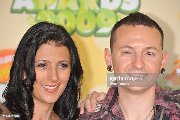 Musician Chester Bennington of the band Linkin Park and his wife arrive at Nickelodeon's 22nd Annual Kids' Choice Awards held at UCLA's Pauley...