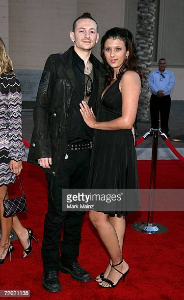 Musician Chester Bennington of the band Linkin Park and wife Talinda arrive at the 2006 American Music Awards held at the Shrine Auditorium on...