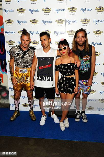 Musician Chole Whittle singer Joe Jonas musician JinJoo Lee and musician Jack Lawless of DNCE arrive at the Rehab Beach Club pool party at the Hard...