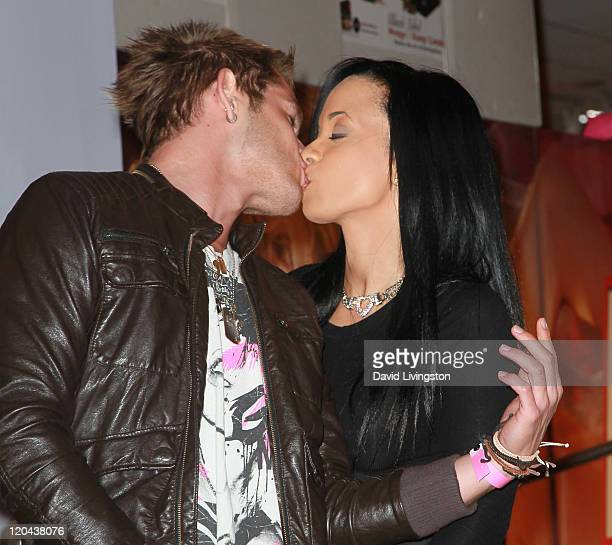 Musician Chris Bundas and author Karrine Steffans attend a party and signing for Steffans' book SatisFaction at Hustler Hollywood on August 5 2011 in...
