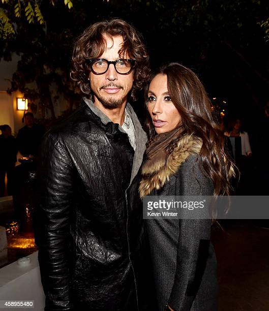 Musician Chris Cornell and his wife Vicky Karayiannis pose at a private reception and dinner for Jimmy Page to celebrate his new autobiography 'Jimmy...