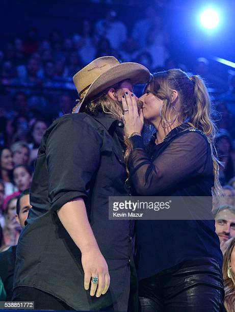 Musician Chris Stapleton and Morgane Stapleton onstage during the 2016 CMT Music awards at the Bridgestone Arena on June 8 2016 in Nashville Tennessee