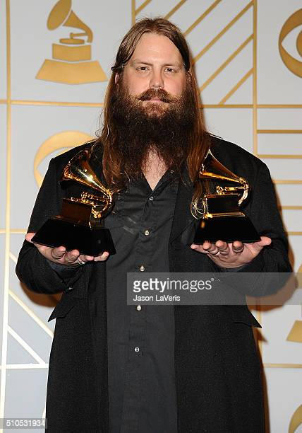 Musician Chris Stapleton poses in the press room at the The 58th GRAMMY Awards at Staples Center on February 15 2016 in Los Angeles California