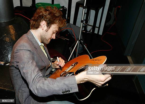 Musician Chris Thile signs a guitar during the Tribeca ASCAP Music Lounge at the 2008 Tribeca Film Festival on April 29 2008 in New York City