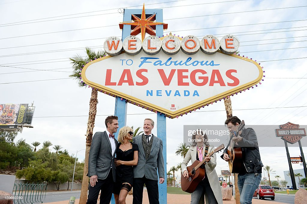 Musician Chrissie Hynde of Pretenders (2nd from R) performs during production designer Jack Ryan's (L) and Senior VP of media campaigns for PETA Dan Mathews (C) wedding at the Welcome to Fabulous Las Vegas sign with actress Pamela Anderson (2nd from L) as Maid of Honor on November 27, 2014 in Las Vegas, Nevada