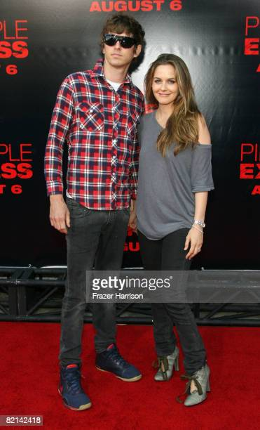 Musician Christopher Jarecki and Alicia Silverstone arrive at the Premiere Of Columbia Pictures' 'Pineapple Express' on July 31 2008 at the Mann...