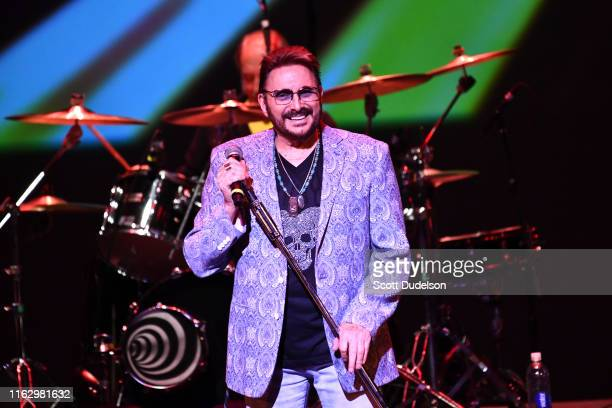 Musician Chuck Negron, founding member of the band Three Dog Night, performs onstage during the 10th anniversary of the Happy Together Tour at...
