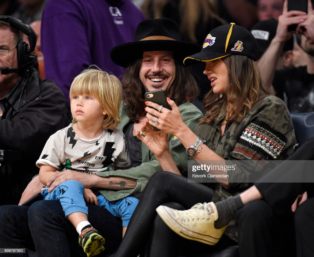 Musician Cisco Adler (C) son Ace (L) and wife model Barbara Stoyanoff attend the Washington Wizards and Los Angeles Lakers basketball game at Staples Center March 28 2017, in Los Angeles, California.