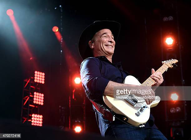 Musician Clint Black performs onstage during ACM Presents Superstar Duets at Globe Life Park in Arlington on April 18 2015 in Arlington Texas