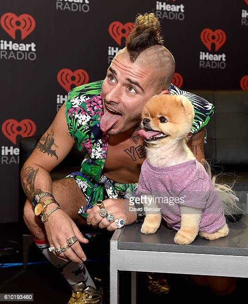 Musician Cole Whittle of DNCE and Jiff the pomeranian attend the 2016 Daytime Village at the iHeartRadio Music Festival at the Las Vegas Village on...