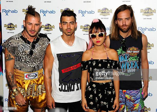 Musician Cole Whittle singer Joe Jonas musician JinJoo Lee and musician Jack Lawless of DNCE arrive at the Rehab Beach Club pool party at the Hard...
