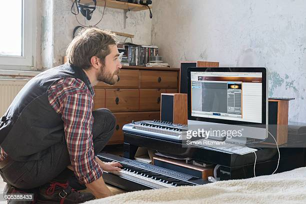 Musician composing a song with computer
