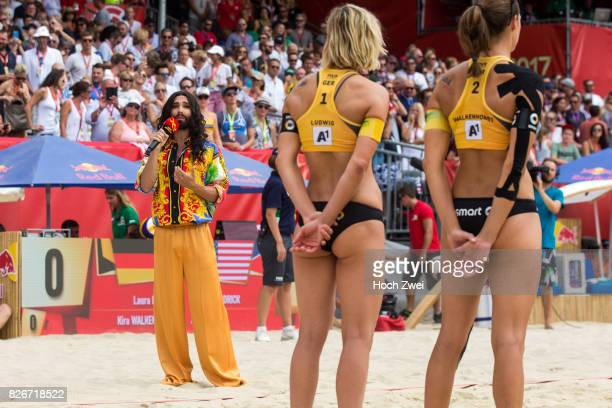 Musician Conchita Wurst sings the national hymne during Day 9 of the FIVB Beach Volleyball World Championships 2017 on August 5 2017 in Vienna Austria