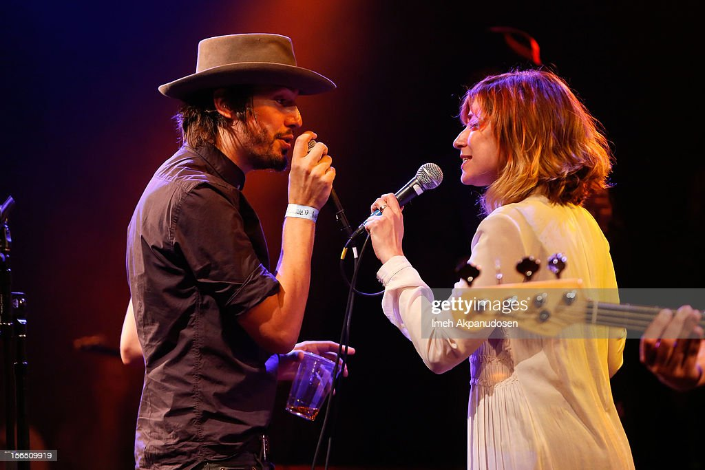 Musician Cory Chisel of Cory Chisel And The Wandering Sons (L) and singer/songwriter Nicole Atkins perform onstage singing 'Handle with Care' at the first ever Jameson Petty Fest West at El Rey Theatre on November 15, 2012 in Los Angeles, California.