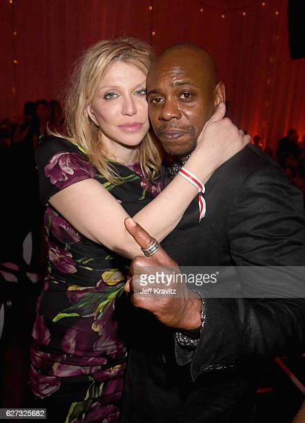 Musician Courtney Love and comedian Dave Chappelle attend Madonna presents An Evening of Music Art Mischief and Performance to benefit Raising Malawi...