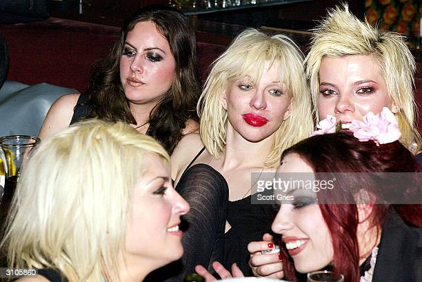 Musician Courtney Love parties with her bandmates before their peformance at Plaid on March 17 2004 in New York City