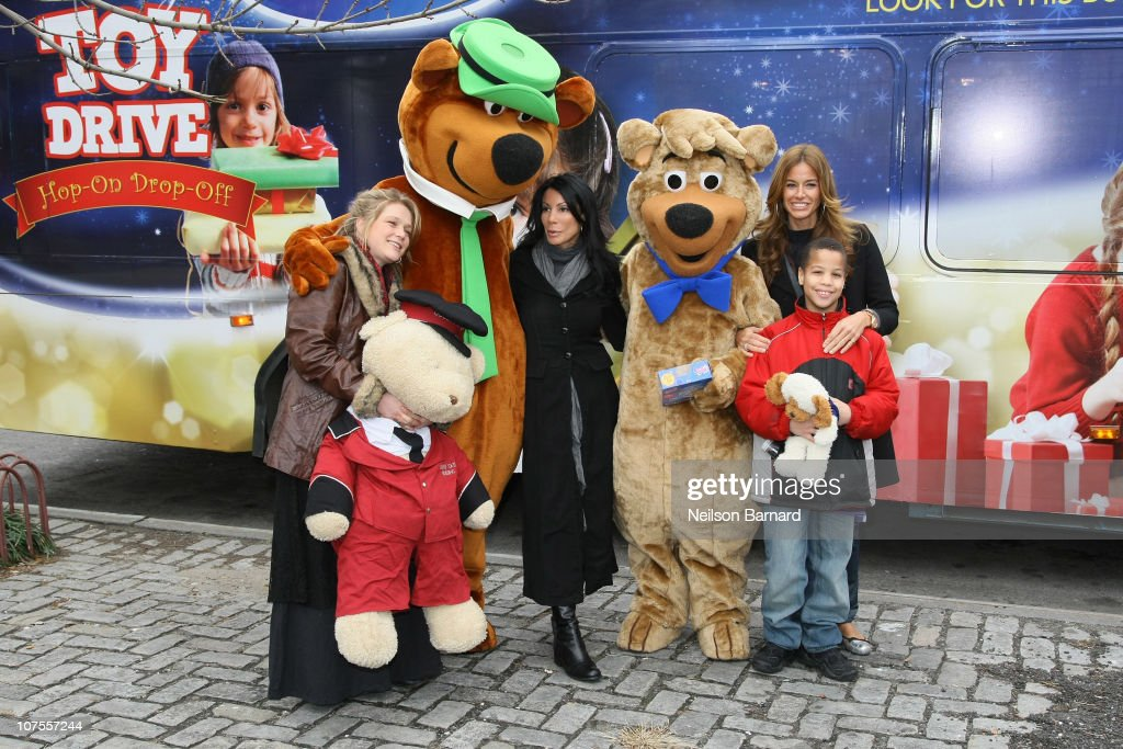 Musician Crystal Bowersox, and TV personalities Danielle Staub and Kelly Bensimon along with Yogi Bear and Boo Boo attend CitySights NY's 2010 Holiday Joy Toy Drive at The Children's Aids Society on December 13, 2010 in New York City.
