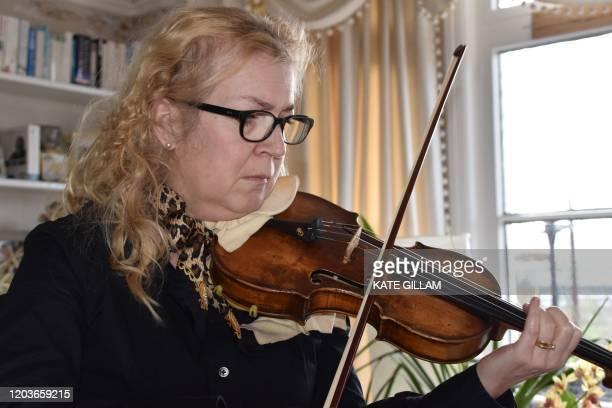 Musician Dagmar Turner poses for a photograph in her home at East Cowes on the Isle of Wight off the south coast of England on February 26 2020 It's...