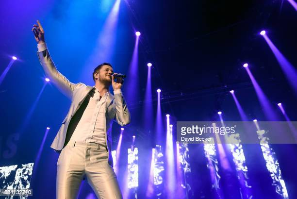 Musician Dan Reynolds of Imagine Dragons performs at the Vegas Strong Benefit Concert at TMobile Arena to support victims of the October 1 tragedy on...