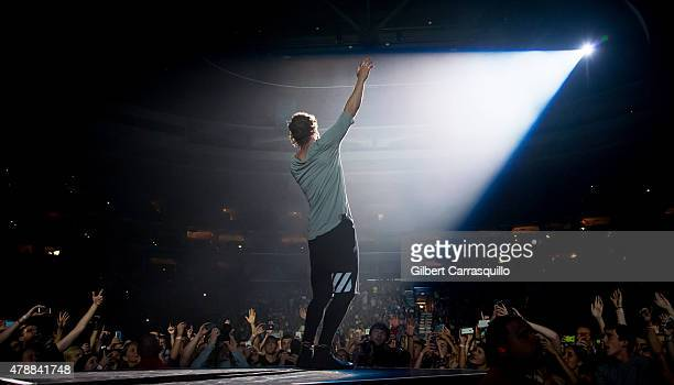 Musician Dan Reynolds of Imagine Dragons performs during Smoke Mirrors Tour at Wells Fargo Center on June 27 2015 in Philadelphia Pennsylvania