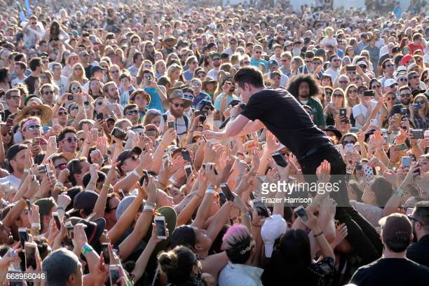 Musician Dan Smith of Bastille crowd surfs at the Outdoor Stage during day 2 of the Coachella Valley Music And Arts Festival at the Empire Polo Club...