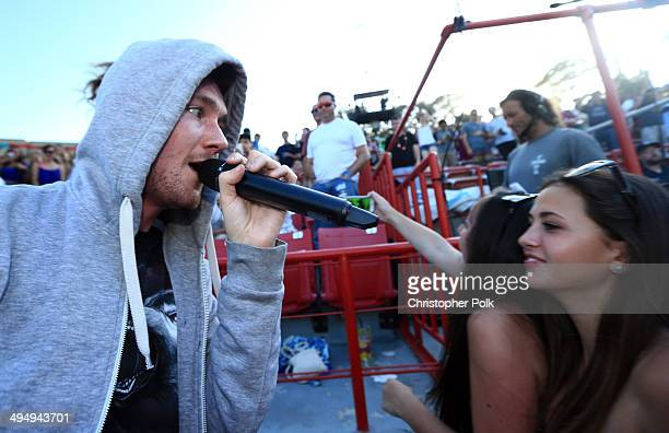 Musician Dan Smith of Bastille performs onstage during the 22nd Annual KROQ Weenie Roast at Verizon Wireless Music Center on May 31 2014 in Irvine...