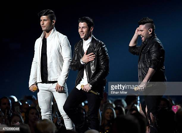 Musician Dan Smyers Shay Mooney of Dan Shay and singer/actor Nick Jonas perform onstage during the 50th Academy of Country Music Awards at ATT...