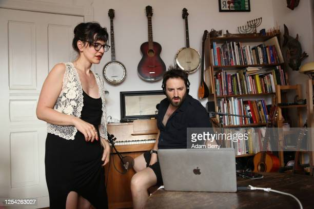 Musician Daniel Kahn and his wife and camera operator Yeva Lapsker set up a video connection in order to livestream his performance from their...