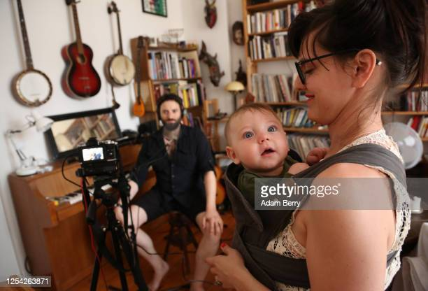 Musician Daniel Kahn speaks to an online audience through a video connection as his wife and camera operator Yeva Lapsker uses a camera to livestream...