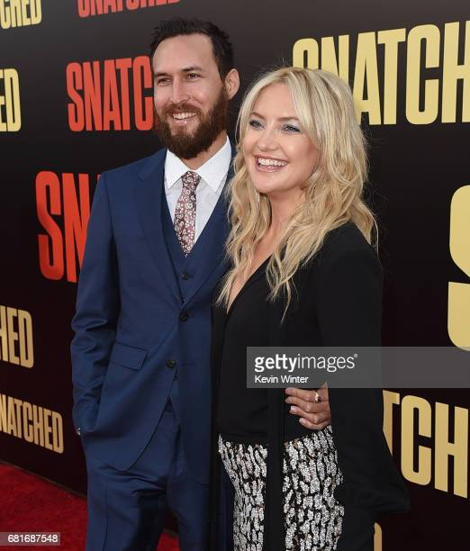 Musician Danny Fujikawa and actor Kate Hudson attend the premiere of 20th Century Fox's 'Snatched' at Regency Village Theatre on May 10 2017 in...