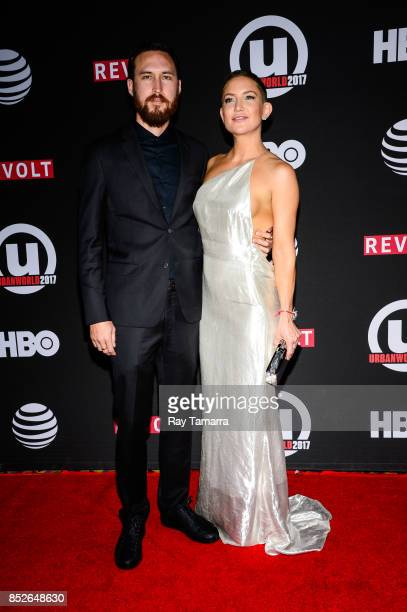 Musician Danny Fujikawa and actress Kate Hudson enter the 21st Annual Urbanworld Film Festival at AMC Empire 25 theater on September 23 2017 in New...