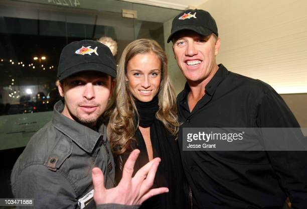 Musician Danny Lohner actress Michelle Merkin and former NFL quarterback John Elway attend the SugarFish by Sushi Nozawa grand opening party on June...