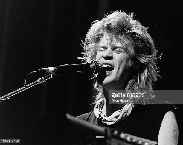 Musician Daryll Hall of the band 'Hall and Oates' singing and playing the piano on stage at the Harlem Apollo Theatre in New York June 3rd 1985