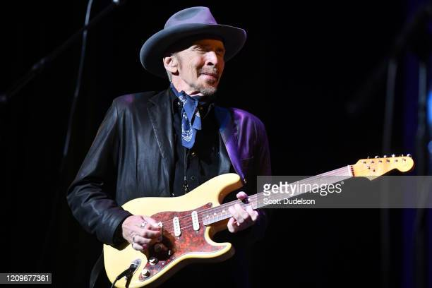 Musician Dave Alvin founding member of The Blasters performs onstage during the Wild Honey Foundation's benefit for Autism Think Tank at Alex Theatre...