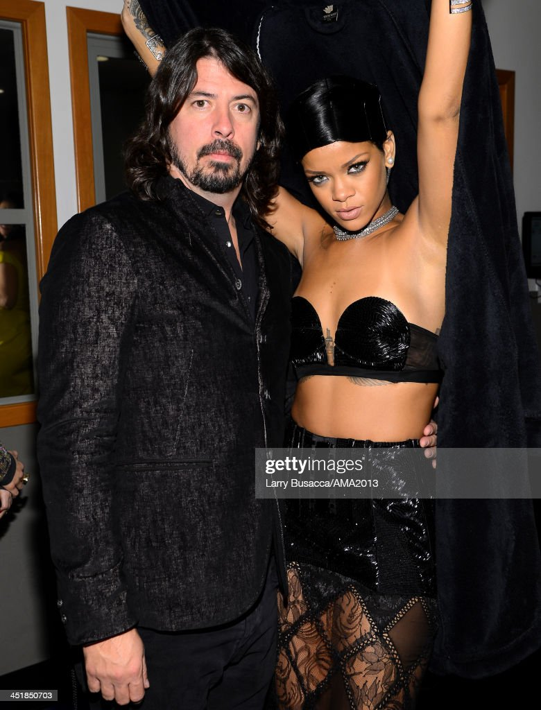 Musician Dave Gohl and singer/recording artist Rihanna attend the 2013 American Music Awards at Nokia Theatre L.A. Live on November 24, 2013 in Los Angeles, California.