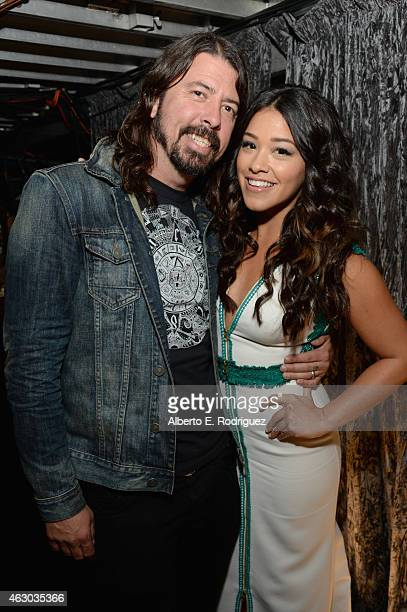 Musician Dave Grohl and actress Gina Rodriguez attend The 57th Annual GRAMMY Awards at STAPLES Center on February 8 2015 in Los Angeles California