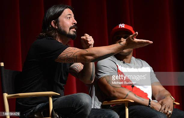 Musician Dave Grohl and and rapper LL Cool J speak during the discussion panel the premiere of The Recording Academy's 'A Death In The Family The...