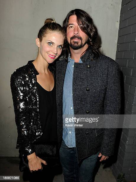 Musician Dave Grohl and his wife Jordyn arrive at Autism Speaks' Blue Jean Ball at Boulevard 3 on October 24 2013 in Los Angeles California