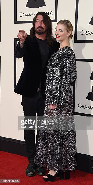 Musician Dave Grohl and his wife Jordyn Blum arrive on the red carpet during the 58th Annual Grammy Music Awards in Los Angeles February 15 2016 AFP...