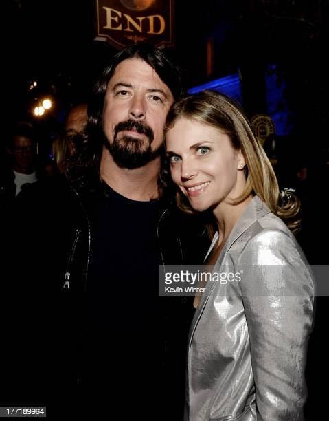 Musician Dave Grohl and his wife Jordyn Blum pose at the after party for the premiere of Focus Features' The World's End at the Cat and Fiddle on...
