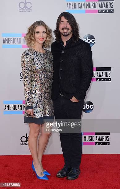 Musician Dave Grohl and Jordyn Blum arrive at the 2013 American Music Awards at Nokia Theatre LA Live on November 24 2013 in Los Angeles California
