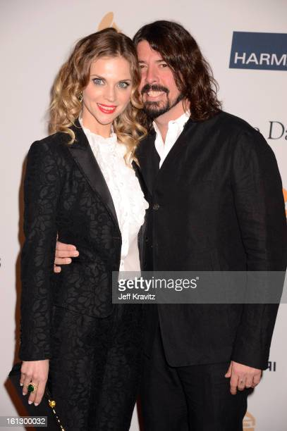 Musician Dave Grohl and Jordyn Blum arrives at Clive Davis and The Recording Academy's 2013 GRAMMY Salute to Industry Icons Gala held at The Beverly...